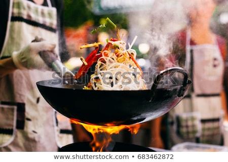Koken wok spinazie klein schaal brand Stockfoto © Hofmeester