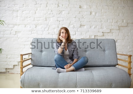 Pretty young woman bored at home stock photo © nenetus