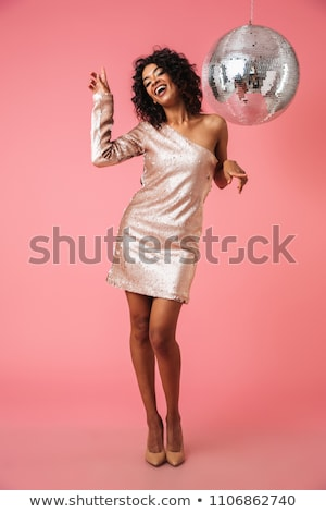 Woman in party dress holding disco ball Stock photo © AndreyPopov