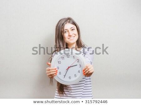 Gülen güzel kız büyük saat ofis kız Stok fotoğraf © fotoatelie