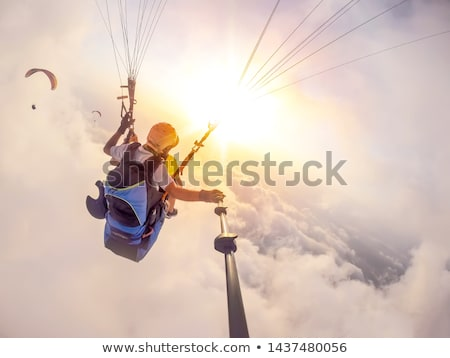 Paragliding fly on blue sky Stock photo © deyangeorgiev