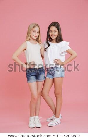 Cute blond vrouw denim shorts modieus Stockfoto © dash