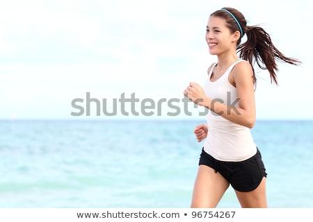heureux · femme · souriante · jogging · plage · photos · femme - photo stock © dolgachov