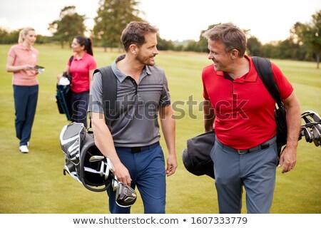 две женщины ходьбе гольф мешки гольф Сток-фото © monkey_business