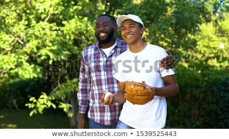 teenage boy playing baseball stock photo © monkey_business