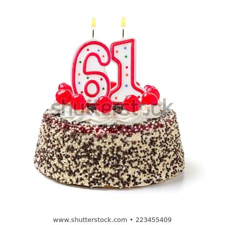 Birthday cake with burning candle number 61 Stock photo © Zerbor