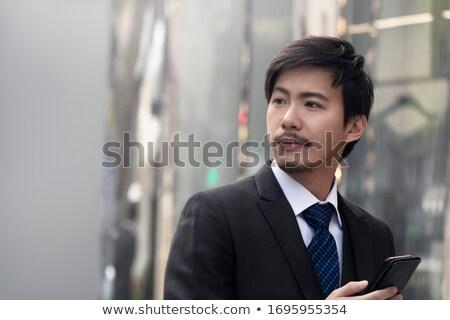 Young Asian businessman stock photo © elwynn