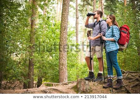 Jonge man verrekijker camping reis voorjaar gelukkig Stockfoto © HighwayStarz