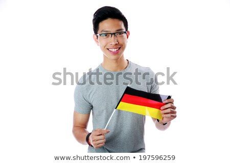 Happy asian student holding flag of Germany over white background Stock photo © deandrobot