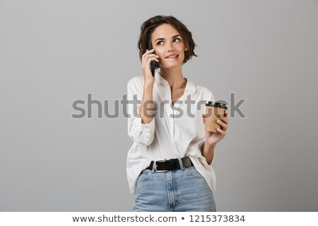 zakenvrouw · praten · mobiele · telefoon · buiten · moderne · kantoorgebouw - stockfoto © deandrobot