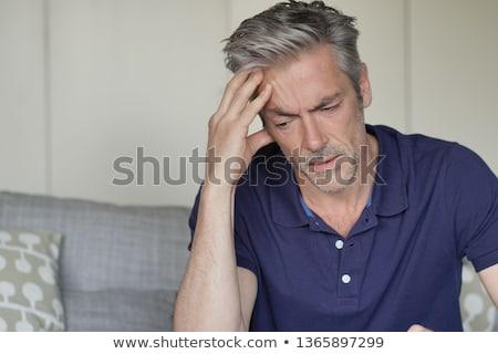Férfi migrén fejfájás felnőtt visel citromsárga Stock fotó © stevanovicigor