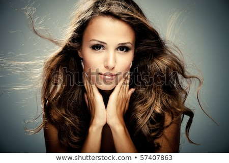 attractive brunette girl model with long wavy hair styling make stock photo © victoria_andreas