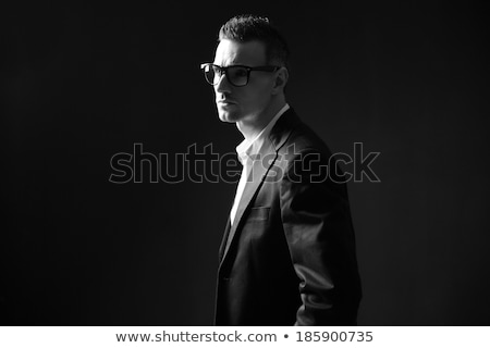 Black and white photo of a thoughtful businessman looking away Stock photo © deandrobot