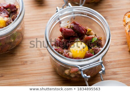 Chef dicing red hot chili peppers Stock photo © juniart
