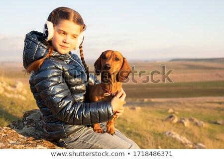 Stock fotó: Izolált · női · portré · barna · tacskó · európai