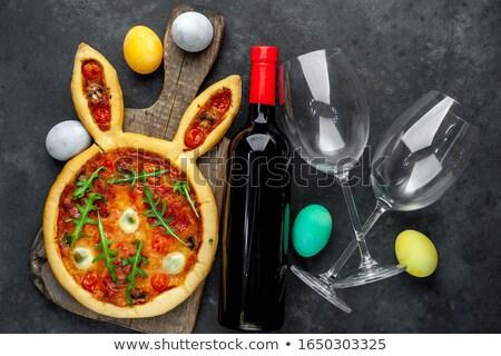 Wineglasses and fresh baked pizza Stock photo © HASLOO