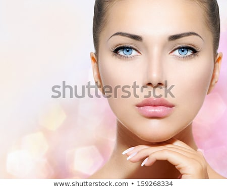 Stock photo: Beautiful woman touching her smooth skin