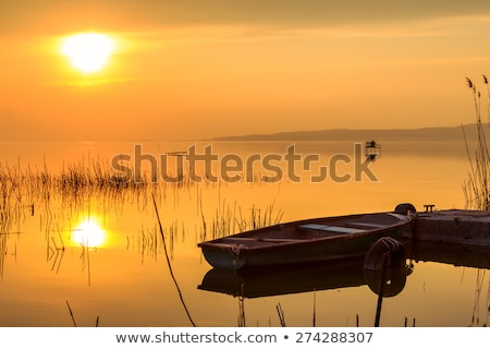 Sunset on the lake Balaton with a boat Stock photo © Fesus