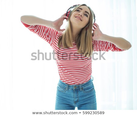 beautiful woman listening to music and singing with live music background stock photo © ainat
