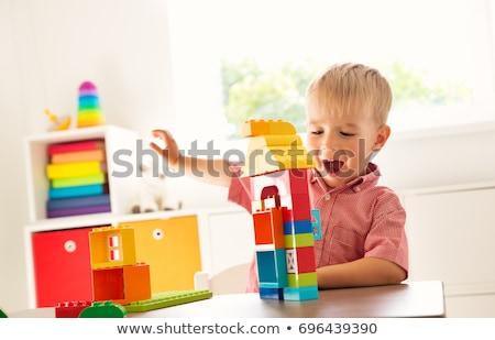 kicsi · fiú · játszik · kockák · ül · színes - stock fotó © wavebreak_media