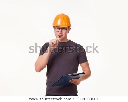 handyman reading clipboard on white background stock photo © wavebreak_media