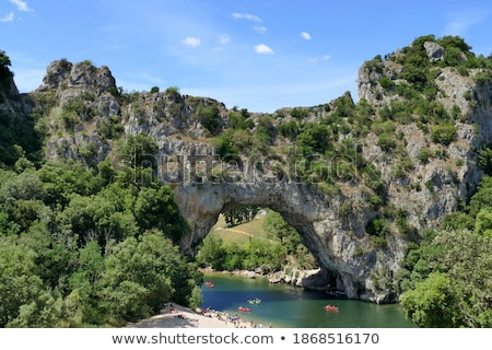 Limestone rock and vegetation over river Stock photo © Juhku
