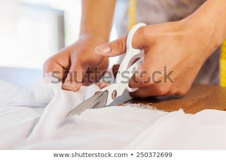 Glimlachend vrouwelijke kleermaker doek workshop Stockfoto © deandrobot