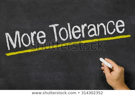 More Tolerance written on a blackboard Stock photo © Zerbor