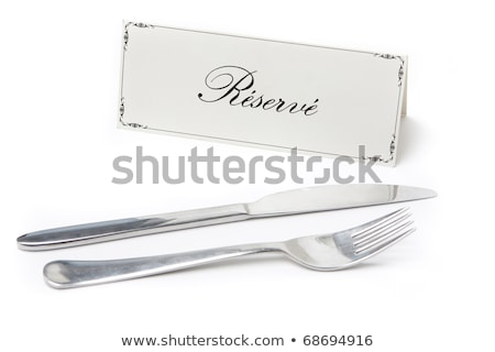 Reserved sign in french with fork and knife Stock photo © hfng