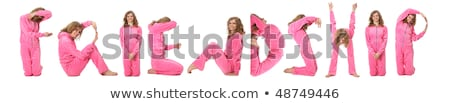 Girl in pink clothes  making word FRIENDSHIP, collage stock photo © Paha_L