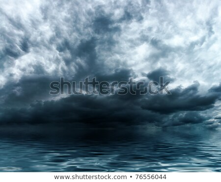 Stormy intense dark clouds over the ocean Stock photo © pzaxe