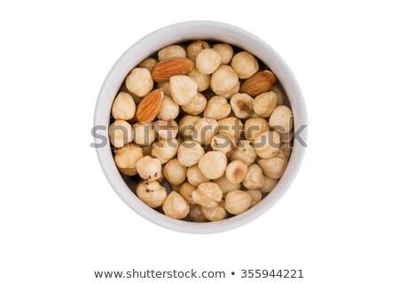 Ramekin of fresh hazelnuts and almonds Stock photo © ozgur