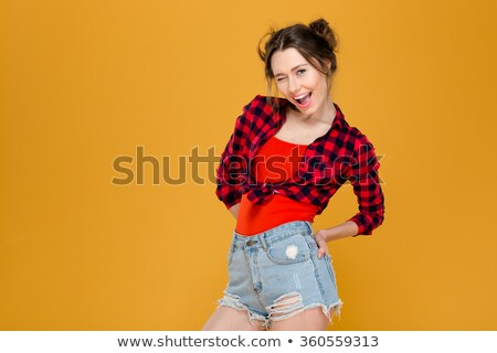 美しい 若い女性 シャツ ジーンズ ショートパンツ ストックフォト © deandrobot