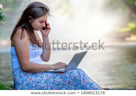 Business woman relaxing near canal Stock photo © dash