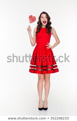 Vrolijk jonge vrouw permanente lolly Blauw vrouw Stockfoto © deandrobot