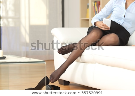 Beautiful female legs in nylon stockings and high heel shoes  stock photo © Elisanth
