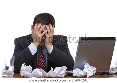 Frustrated man sitting desperate over paper work at desk Stock photo © mikdam