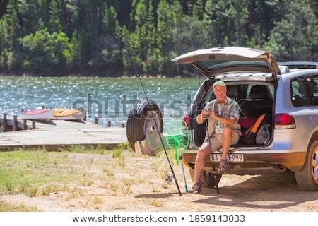 Man in green trunk sitting Stock photo © bluering