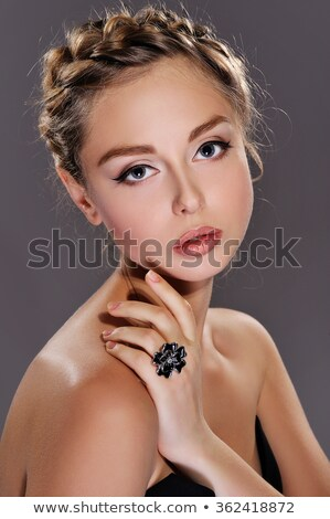 Beauty portrait of tender young woman with shimmering makeup Stock photo © deandrobot