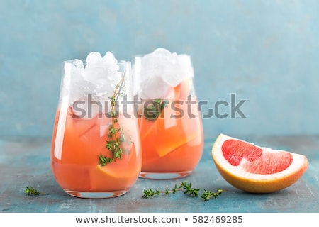 Stockfoto: Grapefruit And Thyme Gin Cocktail Refreshing Drink With Ice