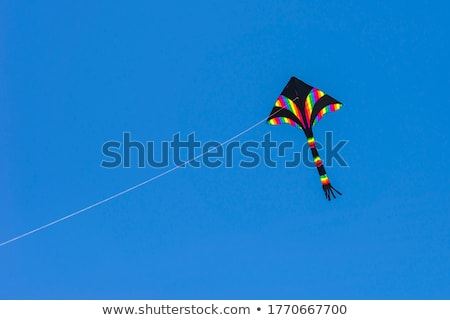 A rainbow colored stunt kite against a blue sky Stock photo © Frankljr