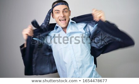 Young businessman in a suit playing silly Stock photo © gsermek