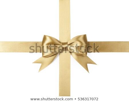 shiny gold satin ribbon on white background stock photo © fresh_5265954