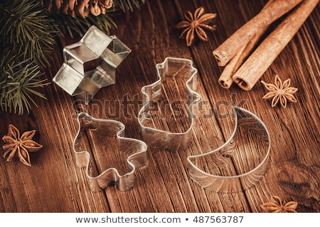 Snowman cutter for cookies on the wooden table Stock photo © alexbaby