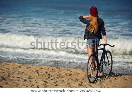 девушки ходьбе велосипедов молодые подростков женщины Сток-фото © iofoto