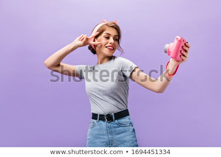 Beautiful dark-haired woman in dress and belt looking away Stock photo © julenochek