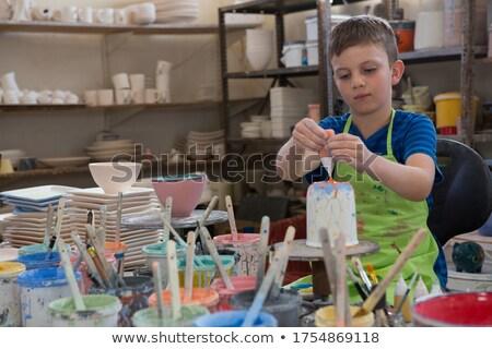 Jongen schilderij kom aardewerk winkel Stockfoto © wavebreak_media