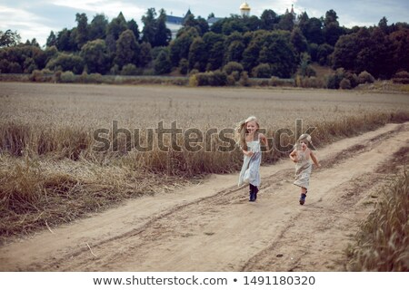 2 girls running in field with windmills Stock photo © IS2