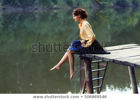 Woman sitting on a pier Stock photo © IS2