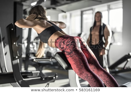fille · exercice · gymnase · charmant · planche · main - photo stock © bezikus